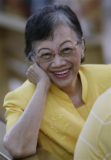 FILE - In this file photo taken Sunday Aug. 17, 2008, cancer-stricken former Philippine President Corazon Aquino smiles to friends inside the church at the Ateneo de Manila University in suburban Quezon City, Philippines. Aquino has been admitted to a hospital in serious condition, her spokeswoman said Wednesday, July 1, 2009. (AP Photo/Aaron Favila, File)