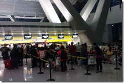 My own shot of a family prevented to travel causing a long queue at the last check-in counter.