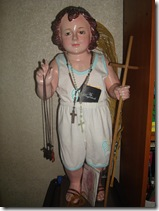 Sto. Nino wearing old baby clothes.