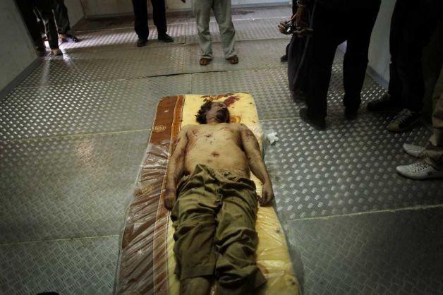 http://ryanericsongcanlas.files.wordpress.com/2011/10/muammar-gaddafi-dead.jpg